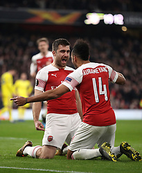 Arsenal's Sokratis Papastathopoulos (left) celebrates scoring his side's third goal of the game with team-mate Pierre-Emerick Aubameyang during the UEFA Europa League round of 32 second leg match at the Emirates Stadium, London.