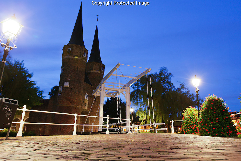 The Old city gates at night in Delft, Holland