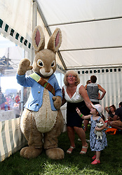 General view of kids meeting Peter the Rabbit during Kids Carnival Day of The Qatar Airways May Racing Carnival at Warwick Racecourse.