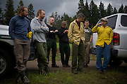 McCall's smokejumper crew discusses landing strategies after a live jump session near the base in McCall, ID.