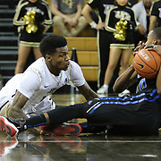 ORLANDO, FL - DECEMBER 31:  B.J. Taylor #1 of the UCF Knights and James Woodard #10 of the Tulsa Golden Hurricane scramble for a loose ball during an NCAA basketball game at the CFE Arena on December 31, 2014 in Orlando, Florida. (Photo by Alex Menendez/Getty Images) *** Local Caption *** B.J. Taylor; James Woodard