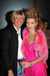 Left to right, SUE CHESTER and her daughter OLIVIA BAKER at a fashion show of the new fashion label Chester Bonham held at the Aston Martin Showroom, Park Lane, London on 15th November 2004.<br /><br />NON EXCLUSIVE - WORLD RIGHTS