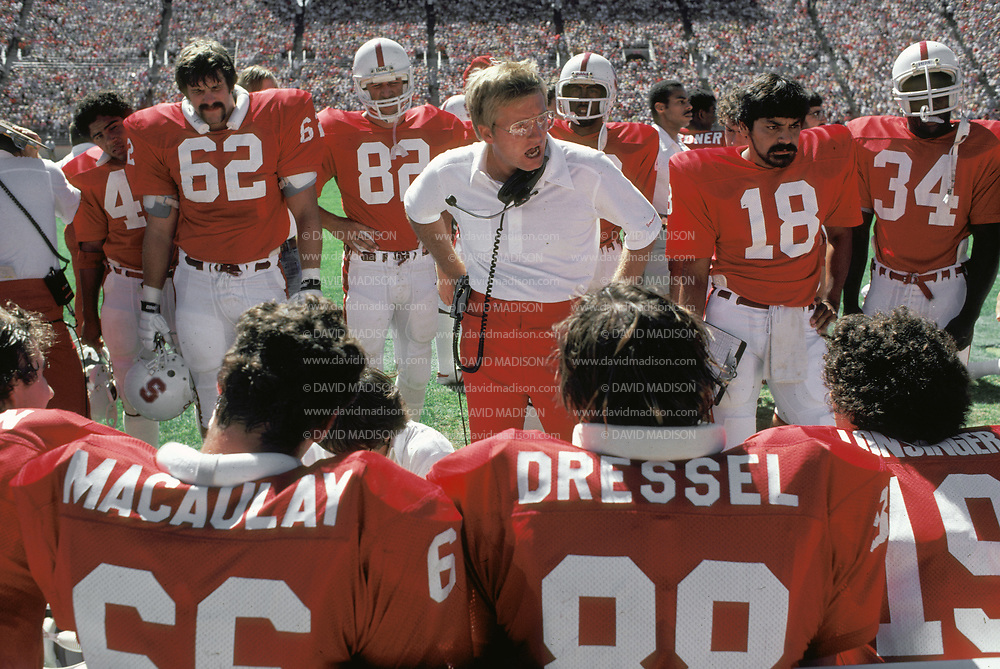 COLLEGE FOOTBALL:  Stanford vs San Jose State on September 19, 1981 at Stanford Stadium in Palo Alto, California.  Stanford Offensive Coordinator Jim Fassel address team on sidelines.  Visible players include John Macaulay #66, Chris Dressel #88, Phil Wilson #18.  Photograph by David Madison ( www.davidmadison.com ).