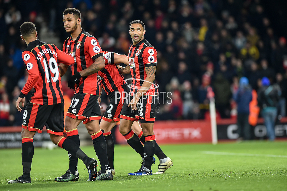 AFC Bournemouth Forward, Callum Wilson (13) scores a penalty goal to make it 2-0 AFC Bournemouth Players Celebrate  during the Premier League match between Bournemouth and Arsenal at the Vitality Stadium, Bournemouth, England on 3 January 2017. Photo by Adam Rivers.