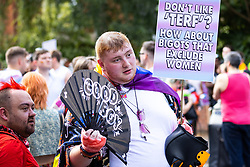"""© Licensed to London News Pictures . 28/08/2021. Manchester, UK. A protester holds up a placard reading """" Don't like TERF? How about bigots that exclude women """" . People take part in a Reclaim Pride march through Manchester City Centre , in opposition to the management of the city's """"official"""" Manchester Pride charity festival . The Manchester Pride charity parade was cancelled in 2020 due to Coronavirus . An """"equality march"""" organised by Manchester Pride charity was due to take place on Deansgate as the protest passed through the Gay Village . Protesters object to Manchester Pride charity's withdrawal of funding for the LGBT Foundation's condom distribution scheme and HIV charity George House Trust as well as increasing commercialisation of the annual event . Photo credit: Joel Goodman/LNP"""