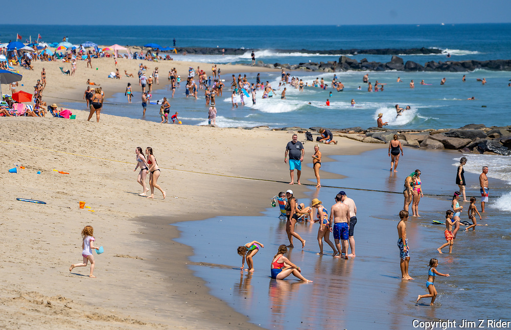 Families enjoy a day a the beach in Asbury Park as summer comes to a close.