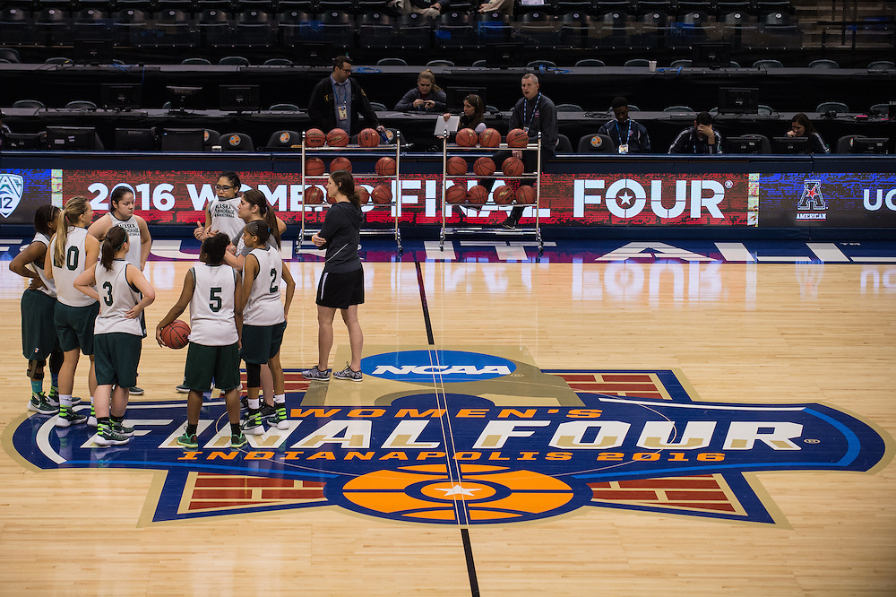 April 2, 2016; Indianapolis, Ind.; Assistant coach Shaina Afoa gives the team instructions during their practice session at Bankers Life Fieldhouse.