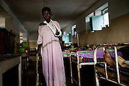 Tereza Polino recuperates in the Tambura Hospital after the  LRA stole her possesions, broke her arm and burnt her home in Zangia, Western Equatoria State.