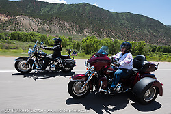 Kellie Naylor, a realtor from Nebraska, on her trike riding from Steamboat Springs to Doc Holliday's Harley-Davidson in Glenwood Springs during the Rocky Mountain Regional HOG Rally, Colorado, USA. Thursday June 8, 2017. Photography ©2017 Michael Lichter.
