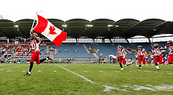 11.07.2011, UPC Arena, Graz, AUT, American Football WM 2011, Group B, Kanada (CAN) vs Oesterreich (AUT), im Bild the Canadian team entering the field// during the American Football World Championship 2011 Group B game, Canada vs Austria, at UPC Arena, Graz, 2011-07-11, EXPA Pictures © 2011, PhotoCredit: EXPA/ E. Scheriau