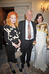 Left to right, DAME VIVIENNE WESTWOOD, TED TURNER and MILLA JOVAVICH at the 3rd Fortune Forum Summit held at The Dorchester Hotel, Park Lane, London on 3rd March 2009.