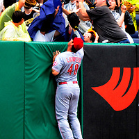 Cincinnati Reds left fielder Ryan Ludwick (48) watches the Pittsburgh Pirates fans scramble for Pittsburgh Pirates third baseman Josh Harrison (5) home-run ball in the first inning at PNC Park in Pittsburgh, on August 31, 2014.  UPI/Archie Carpenter