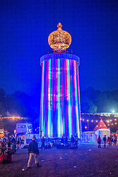 The viewing tower overlooking the site at night. The 2015 Glastonbury Festival, Worthy Farm, Glastonbury.