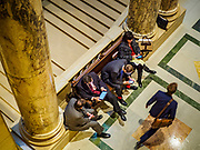 01 MAY 2017 - ST. PAUL, MN: Lobbyists wait for the Minnesota State Senate to go out on a recess. About 300 people, representing immigrants' and workers' rights organizations, marched through the Minnesota State Capitol during a demonstration to mark May Day, International Workers' Day.      PHOTO BY JACK KURTZ