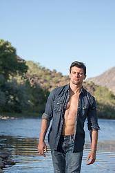 good looking man walking in a river