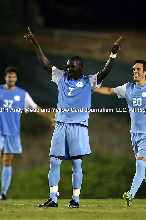 15 August 2014: North Carolina's Nyambi Jabang (7) reacts to scoring a goal from beyond midfield with Warren Marshall (20) and Walker Hume (37). The University of North Carolina Tar Heels hosted the Gardner-Webb University Bulldogs at Fetzer Field in Chapel Hill, NC in a 2014 NCAA Division I Men's Soccer preseason match. North Carolina won the exhibition 7-0.
