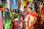 "19 AUGUST 2014 - BANGKOK, THAILAND:  Members of the Lehigh Leng Kaitoung Opera troupe wait to go on stage during a performance at the Chaomae Thapthim Shrine, a small Chinese shrine in a working class neighborhood of Bangkok. The performance was for Ghost Month. Chinese opera was once very popular in Thailand, where it is called ""Ngiew."" It is usually performed in the Teochew language. Millions of Chinese emigrated to Thailand (then Siam) in the 18th and 19th centuries and brought their culture with them. Recently the popularity of ngiew has faded as people turn to performances of opera on DVD or movies. There are still as many 30 Chinese opera troupes left in Bangkok and its environs. They are especially busy during Chinese New Year and Chinese holiday when they travel from Chinese temple to Chinese temple performing on stages they put up in streets near the temple, sometimes sleeping on hammocks they sling under their stage. Most of the Chinese operas from Bangkok travel to Malaysia for Ghost Month, leaving just a few to perform in Bangkok.        PHOTO BY JACK KURTZ"