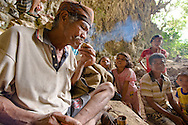 A local Manggarai worker at Liang Bua lights a cigarette from tinders he ignited by striking chert. Hearths  from the hobbit layers of the cave imply that Homo floresiensis used similar technology.