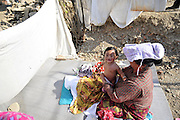 Dec. 29, 2015 - Kathmandu, NP, Nepal -<br /> <br /> Earthquake Survivors struggling in temporary Tent on Winter Season<br /> <br /> Grandmother of PRISHA MAHARJAN, 10 months old, applying mustard oil, which can offer numerous health benefits for infants and kids. Some of which are that it is very good for baby massage, it can keep the body warm during winters, on 29 December, 2015 at Panga, Kirtipur, Kathmandu, Nepal. Most of houses in Panga, Kirtipur were destroyed by recent earthquake on April 25, 2015, a magnitude of 7.8 earthquake killing over 8,000 of people in Nepal and thousands of injured, which Outcomes Hundreds of people were homeless with entire villages across many districts of the country.<br /> ©Exclusivepix Media