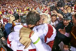 Oct. 15, 2005; USC coach Pete Carroll hugs QB Matt Leinart (11). (Photo by Matt Cashore)