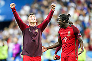 Cristiano Ronaldo, the captain of the portuguese national squad, and Ederzito celebrating the winning of the European Championship held in France. In the final match Portugal beat France by 1-0 on extra-time with a goal scored by Ederzito.