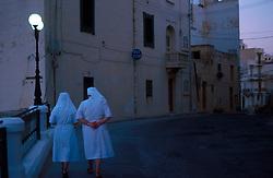 MALTA GOZO MARSALFORN JUL00 - Nuns during an evening stroll in Marsalforn, Gozo.. . jre/Photo by Jiri Rezac. . © Jiri Rezac 2000. . Tel:   +44 (0) 7050 110 417. Email: info@jirirezac.com. Web:   www.jirirezac.com