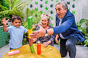 Greenfingers Charity Garden with Richard House Children's Hospice Patrons Jim Carter and Imelda Staunton playing with 3 1/2 year-old Myles During from Upton Park. Press preview day at The RHS Chelsea Flower Show.