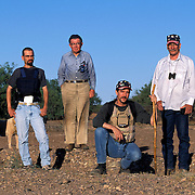 """Chris Simcox, center, with his local, volunteer vigilante patrol near Tombstone, AZ. The group patrols for undocumented migrants crossing the border into the US. Chris Simcox took over the local paper, Tombstone Tumbleweed, in Tombstone, Arizona and proceeded to issue a """"Call to Arms"""" for local residents to form a armed patrol of the nearby US/Mexico border. Simcox formed the vigilante patrol and regularly patrols and captures Mexican nationals crossing the desert into Arizona. Please contact Todd Bigelow directly with your licensing requests. PLEASE CONTACT TODD BIGELOW DIRECTLY WITH YOUR LICENSING REQUEST. THANK YOU!"""