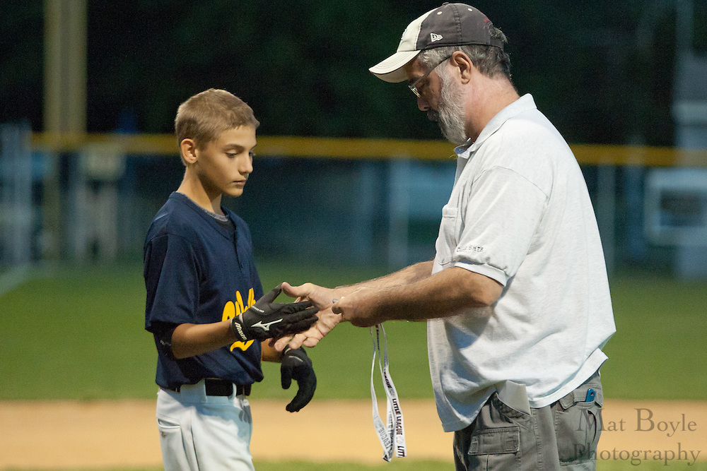 Woodbury's Brandon Buckley receives a medallion for finishing second in the  District 15 Little League tournament on Thursday July 14th.