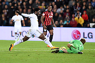 Wilfried Bony of Swansea city is denied by the save from QPR goalkeeper Robert Green. . Barclays Premier league match, Swansea city v Queens Park Rangers at the Liberty stadium in Swansea, South Wales on Tuesday 2nd December 2014<br /> pic by Andrew Orchard, Andrew Orchard sports photography.