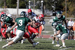 07 October 2006:Red ManTyson Mengel bursts into the secondary. The Titans of Illinois Wesleyan University started off strong with a touchdown on the 2nd play from scrimmage in the game.  The Titans led most of the way, but failed to maintain the lead in the 4th quarter giving up the decision of this CCIW conference game to the Red Men of Carthage by a score of 31 - 28. Action was at Wilder Field on the campus of Illinois Wesleyan University in Bloomington Illinois.<br />
