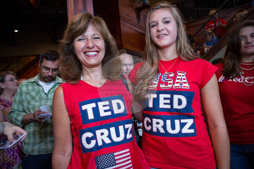 Mother and daughter supporters of U.S. Senator and GOP presidential candidate Ted Cruz wait for him to arrive for the kick off of his campaign bus tour at the Liberty Tap Room restaurant August 7, 2015 in Mt Pleasant, South Carolina. Cruz began a seven-day bus tour called the Cruz Country Bus Tour of southern states following the event.