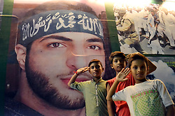 August 27, 2017 - Hyderabad, Sindh, Pakistan - Children salute the photo of Burhan Bani which was placed on Azadi train as its reaches on Hyderabad railway station (Credit Image: © Janali Laghari/Pacific Press via ZUMA Wire)
