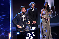Olivier Giroud (left) accepts the Puskas Award for goal of the season during the Best FIFA Football Awards 2017 at the Palladium Theatre, London.