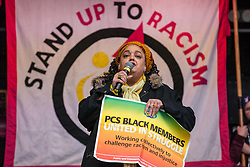London, UK. 16th March, 2019. Zita Hobourne of the Public and Commercial Services Union (PCS) and Black Activists Rising Against Cuts (BARAC) addresses thousands of people on the March Against Racism demonstration on UN Anti-Racism Day against a background of increasing far-right activism around the world and a terror attack yesterday on two mosques in New Zealand by a far-right extremist which left 49 people dead and another 48 injured.