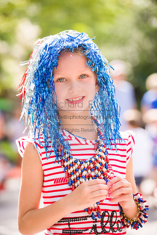 A young girl wearing patriotic costume smiles during the I'On neighborhood Independence Day parade July 4, 2015 in Mt Pleasant, South Carolina.