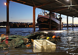 Licensed to London News Pictures. 05/12/2013. North Shields, UK, A high tide of over 6.6m - over 1m higher than predicted - floods the Fish Quay at North Shields. Photo credit: Adrian Don/LNP