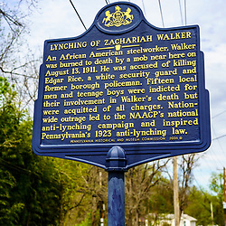 Coatesville, PA / USA - May 3, 2020: A Pennsylvania historic marker noting the Lynching of  Zachariah Walker, black steel worker who was dragged from a hospital and thrown in a raging steel mill fire.