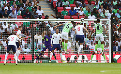 England's Gary Cahill (second right) scores his side's first goal of the game during the International Friendly match at Wembley Stadium, London.