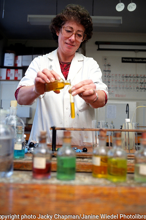Female science teacher in laboratory during science class.