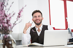 Businessman laughing desk office computer