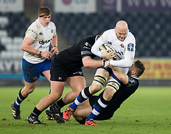 Bath Rugby's Matt Garvey is tackled by Ospreys' Ifan Phillips<br /> <br /> Photographer Simon King/Replay Images<br /> <br /> Anglo-Welsh Cup Round 4 - Ospreys v Bath Rugby - Friday 2nd February 2018 - Liberty Stadium - Swansea<br /> <br /> World Copyright © Replay Images . All rights reserved. info@replayimages.co.uk - http://replayimages.co.uk