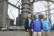 SHOT 10/29/18 9:45:57 AM - Sunrise Cooperative is a leading agricultural and energy cooperative based in Fremont, Ohio with members spanning from the Ohio River to Lake Erie. Sunrise is 100-percent farmer-owned and was formed through the merger of Trupointe Cooperative and Sunrise Cooperative on September 1, 2016. Photographed at the Clyde, Ohio grain elevator was George D. Secor President / CEO and John Lowry<br /> Chairman of the Board of Directors with  CoBank RM Gary Weidenborner. (Photo by Marc Piscotty © 2018)