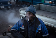 A miner rests as he waits to start loading raw coal to be transported to the capital from the an informal mine in Nalaikh, a poor urban district 36 km east of Ulaanbaatar, Mongolia, January 16, 2019. Coal is at the centre of the pollution crisis gripping the Mongolian capital. It is cheap and readily available to a majority of a population that live off the power grid and in informal settlements.