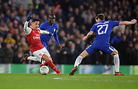 Football - 2017 / 2018 Carabao (EFL/League) Cup - Semi-Final, First Leg: Chelsea vs. Arsenal<br /> <br /> Alexis Sanchez of Arsenal turns to avoid Andreas Christensen and N' Golo Kante, at Stamford Bridge.<br /> <br /> COLORSPORT/ANDREW COWIE
