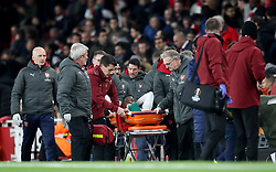 Arsenal's Danny Welbeck is carried off the pitch on a stretcher after picking up an ankle injury