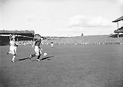 Play kicks ball during the Down v Offaly All Ireland Senior Gaelic Football Final in Croke Park on 24th September 1961. Down 3-6 Offaly 2-8. people on roof of stand.