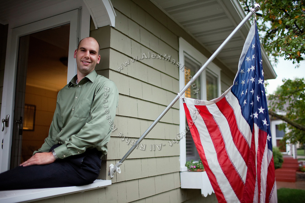 Benjamin Tippetts, 27, is sitting in front of his home in La Crosse, WI, USA, where he works as a freelance financial advisor. He lives with his wife and his newborn daughter. Benjamin has been an Army infantryman in Fallujah, fighting in the 2nd battle in 2004. ......
