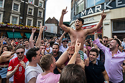 © Licensed to London News Pictures. 07/07/2018. London, UK. England fans celebrate in the street by London Bridge after England's 2-0 victory against Sweden in the World Cup Quarter Finals. Photo credit: Rob Pinney/LNP
