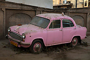 A classic pink Hindustan Ambassador car on 4th February 2018 in Jaipur, Rajasthan, India. Despite its British origins, the Ambassador produced from 1958 to 2014 was considered as a definitive Indian car and was fondly called the king of Indian roads.